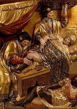 San Kosme eta San Damian, beltz bati hanka mozten, apaiz bat osatzeko.