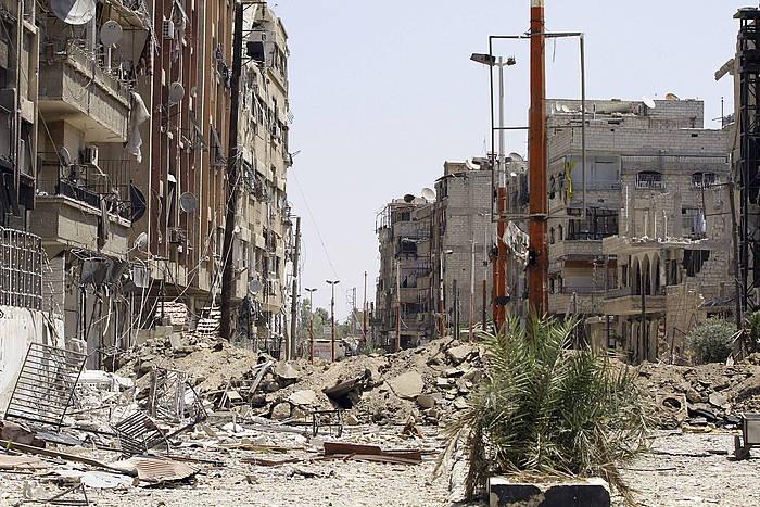 Estatu Islamikoaren esku dago Siriaren zati handi bat. Argazkian Mleha hiria Siriako armadak berreskuratu berritan.