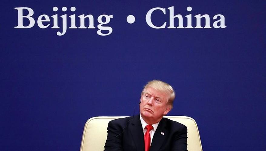 Donald Trump Xi Jinpingen hitzaldia entzuten, joan den ostegunean, Pekinen. ©XINHUA / EFE